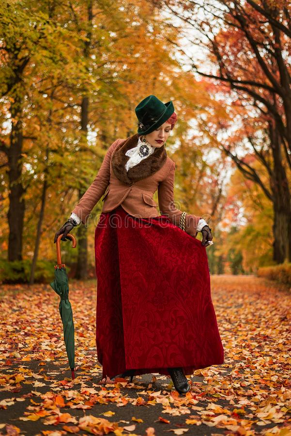 Beautiful woman dancing with umbrella in the park royalty free stock photos