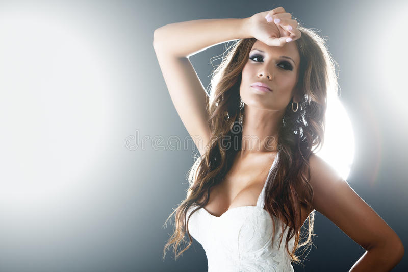 Beautiful woman on dark background with lights royalty free stock photo