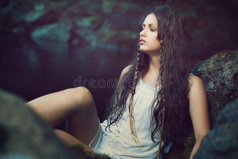 Beautiful woman in dark ethereal stream stock images