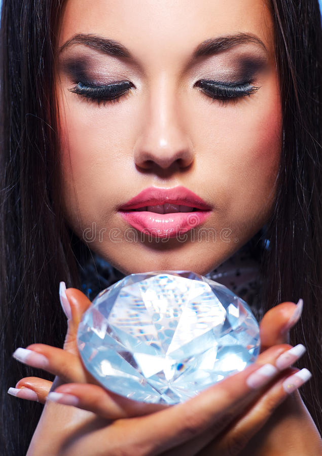 Beautiful woman with a diamond royalty free stock photo
