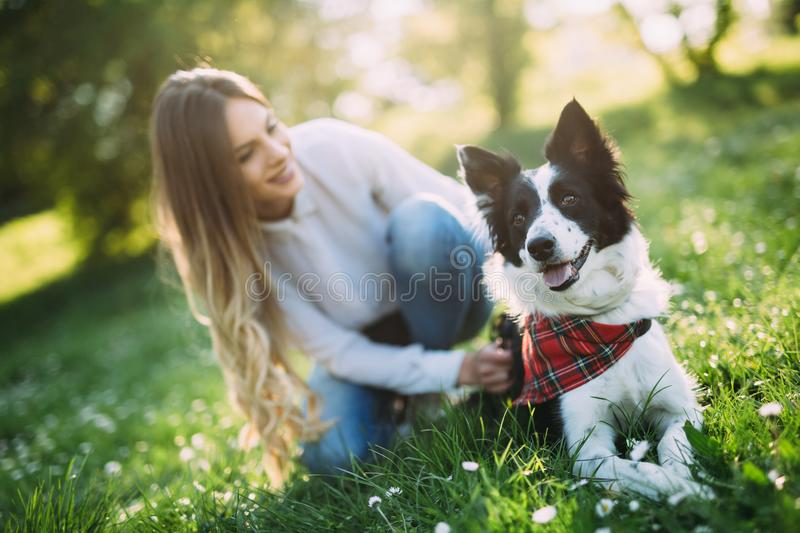 Beautiful woman and dog enjoying their time in nature royalty free stock photography
