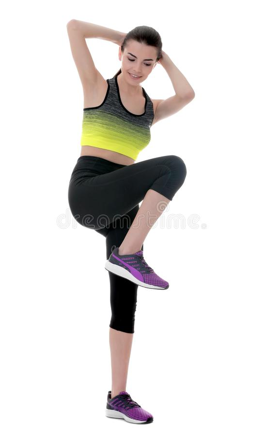 Beautiful woman doing bicycle crunch stock images