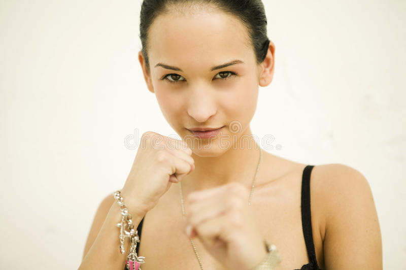Beautiful Woman Doing Boxing Movement Royalty Free Stock Photos
