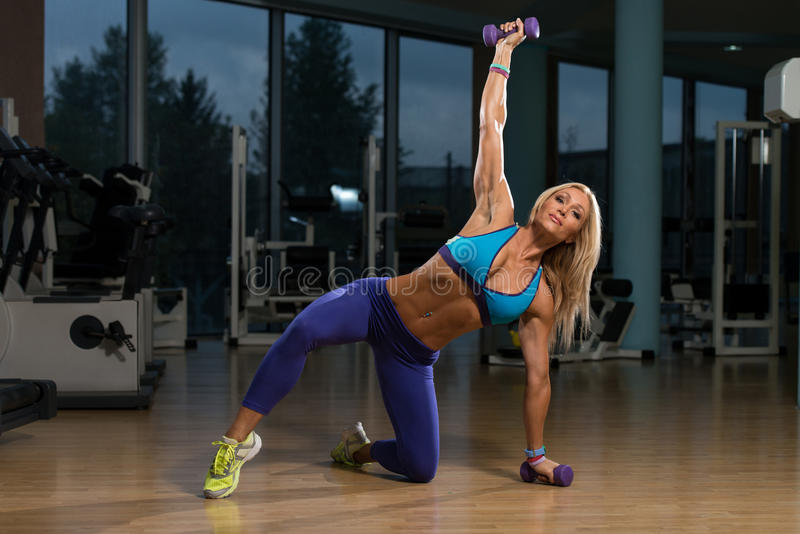 Beautiful Woman Doing Pilates Dumbbell In Fitness Center royalty free stock photo