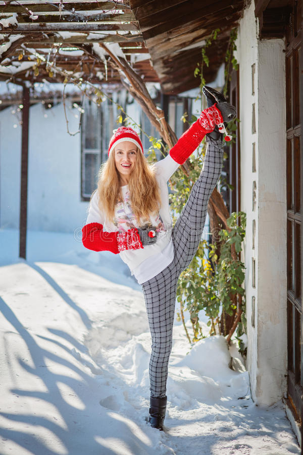 Beautiful woman doing yoga outdoors in the snow stock images
