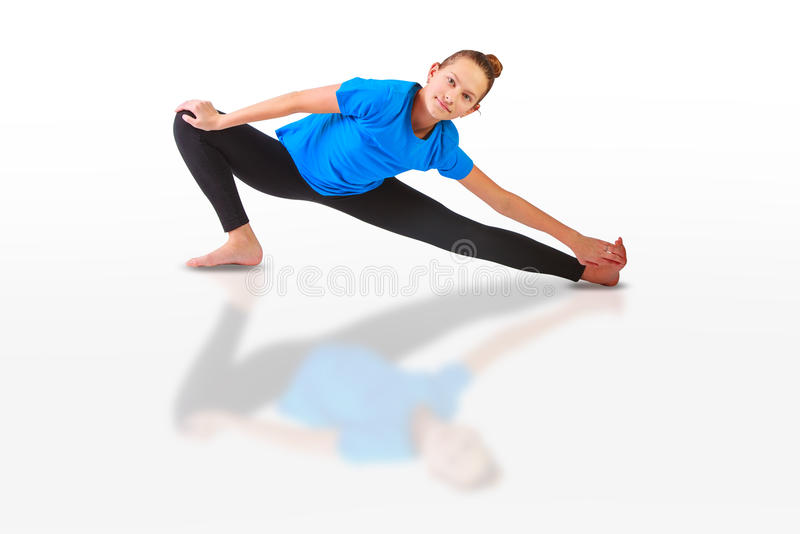 Beautiful woman doing yoguna white background. Beautiful flexible woman doing yoguna white background royalty free stock photo