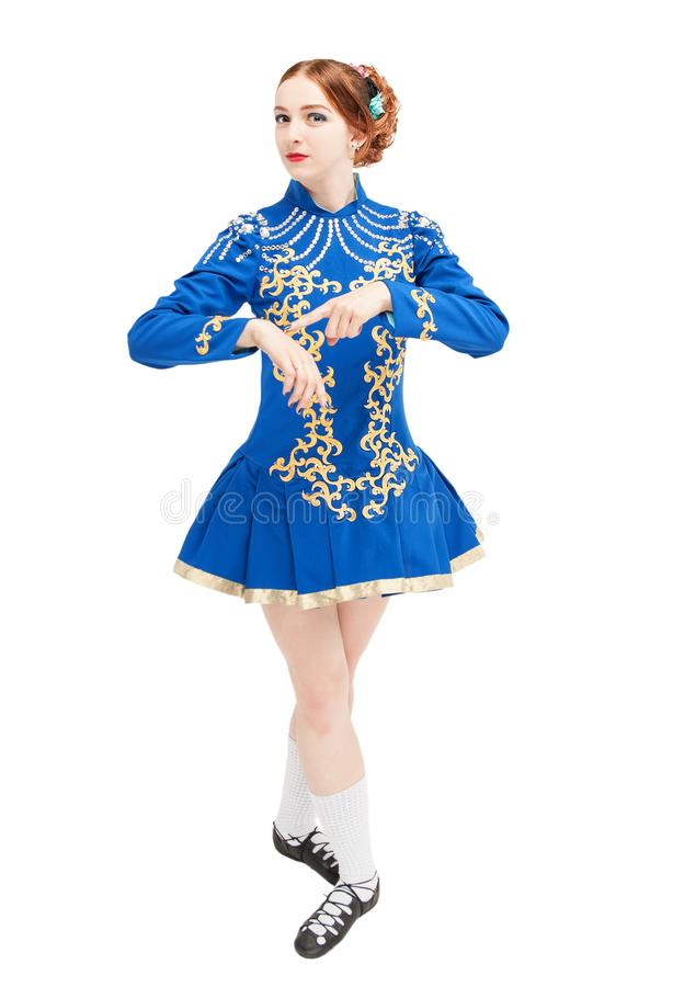 Beautiful woman in dress for Irish dance pointing on hand isolated. On white stock images
