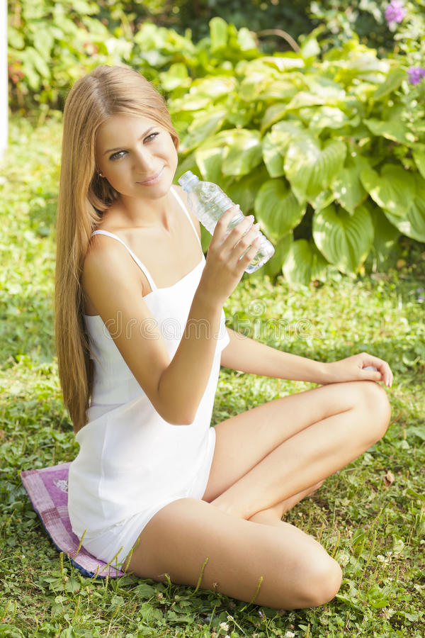 Beautiful Woman Dring Water In Nature royalty free stock photography