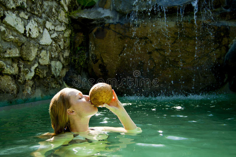 Download Beautiful Woman Drinking Coconut Stock Photo - Image: 16108986