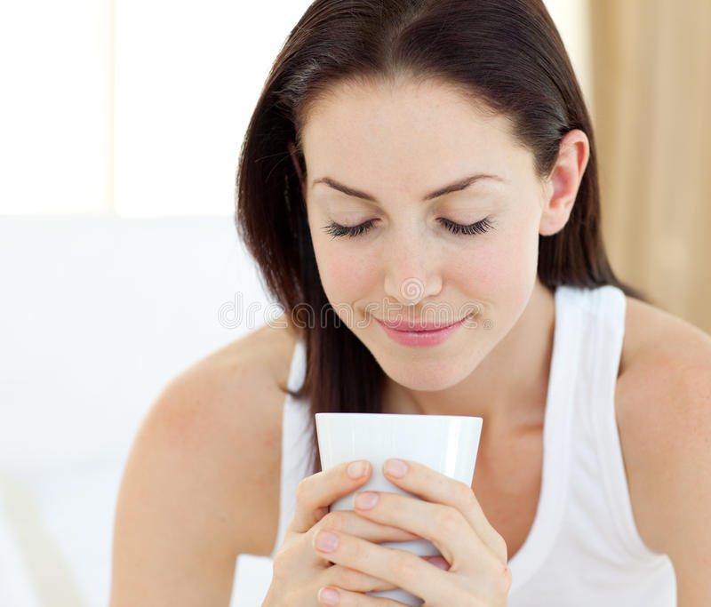 Beautiful woman drinking a coffee stock photo