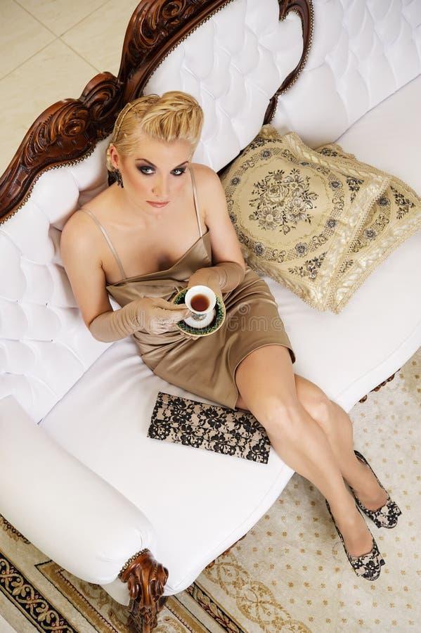 Beautiful woman drinking coffee stock photography