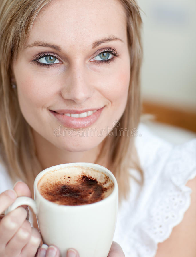 Beautiful woman drinking a coffee at home royalty free stock image
