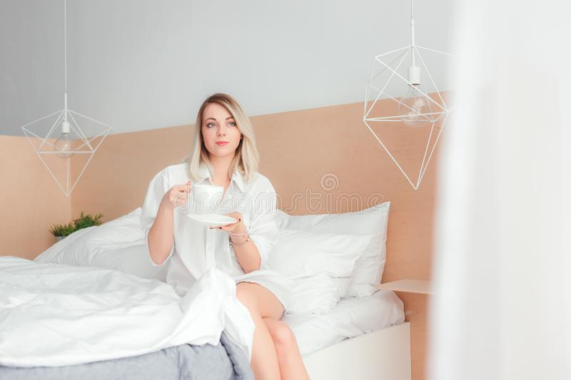 Beautiful woman drinking a coffee stock images