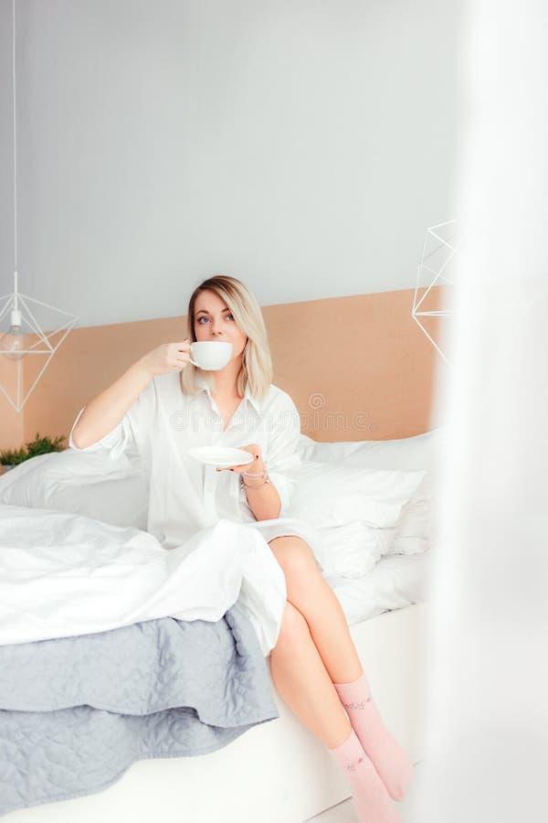 Beautiful woman drinking a coffee royalty free stock photo