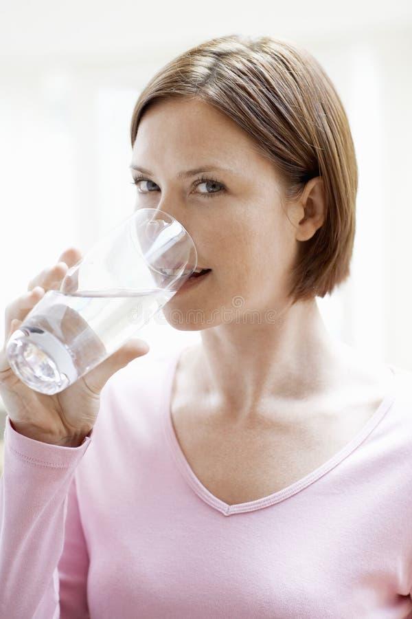 Beautiful Woman Drinking Glass Of Water stock photo
