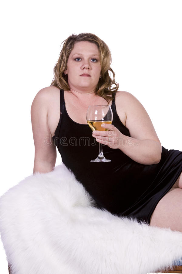 Download Beautiful Woman Drinking Wine On The Couch Stock Image - Image: 13976227