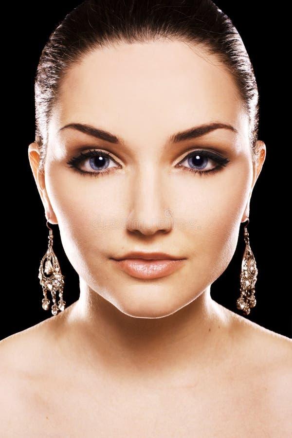 Beautiful woman earing diamond earrings stock photos