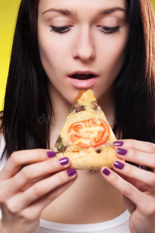 Beautiful woman eat pizza. Young beautiful woman eat pizza stock images