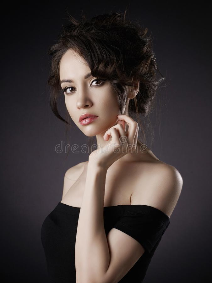 Beautiful woman with elegant hairstyle on black background stock photo