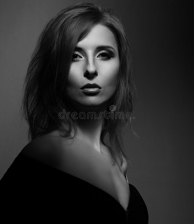 Beautiful woman with elegant neck and nude shoulder in fashion b royalty free stock photo
