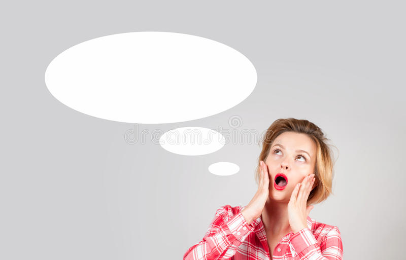 Beautiful woman with empty speech bubbles, looking up. stock photos