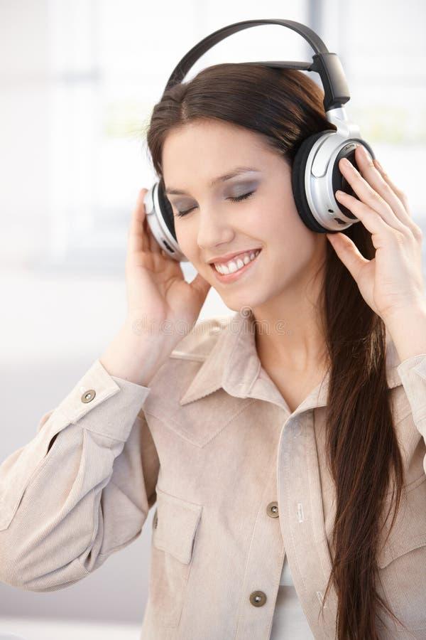Beautiful Woman Enjoying Music Royalty Free Stock Photography