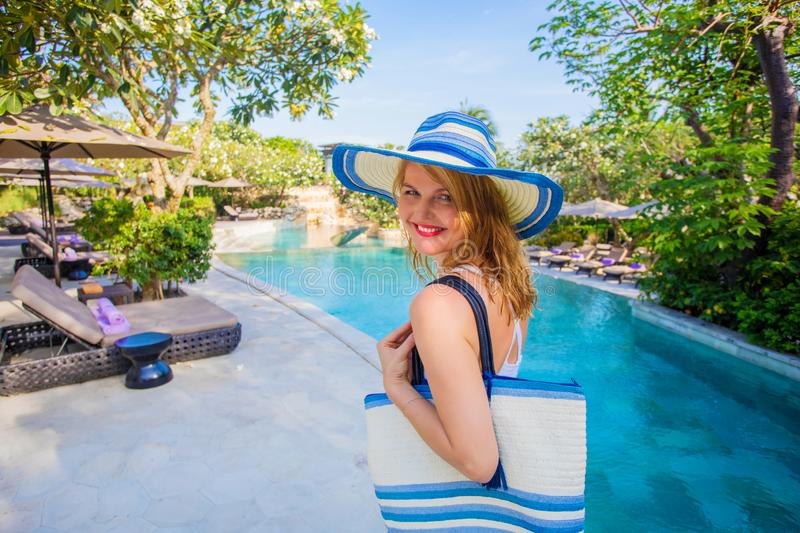 Woman enjoying vacation in tropical getaway royalty free stock photos