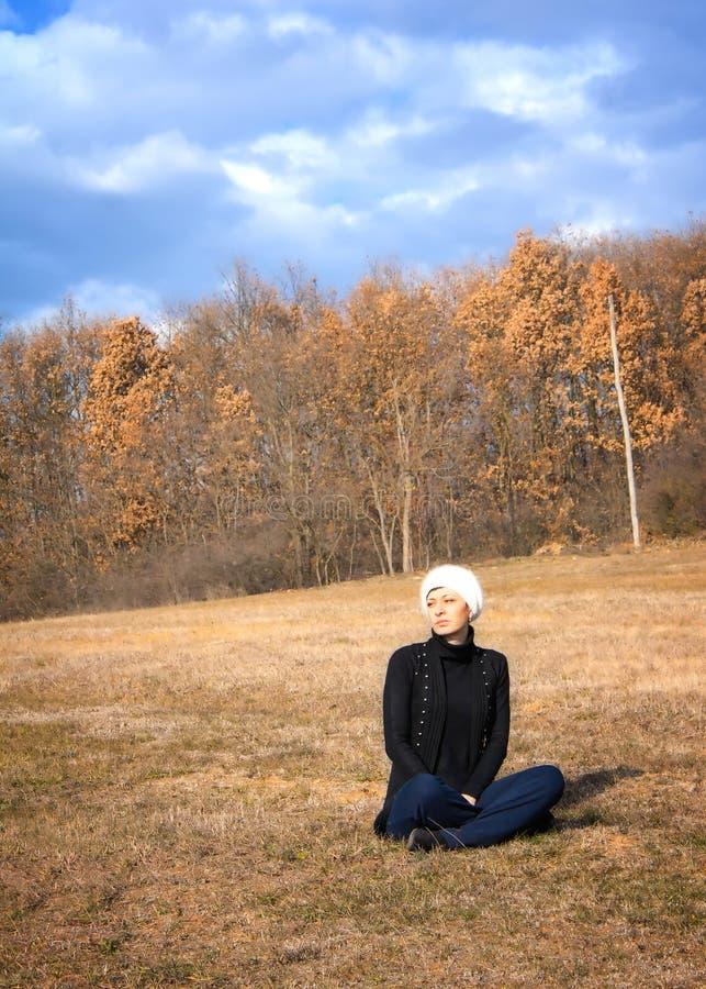 Beautiful woman enjoying the warm autumn sun stock photography