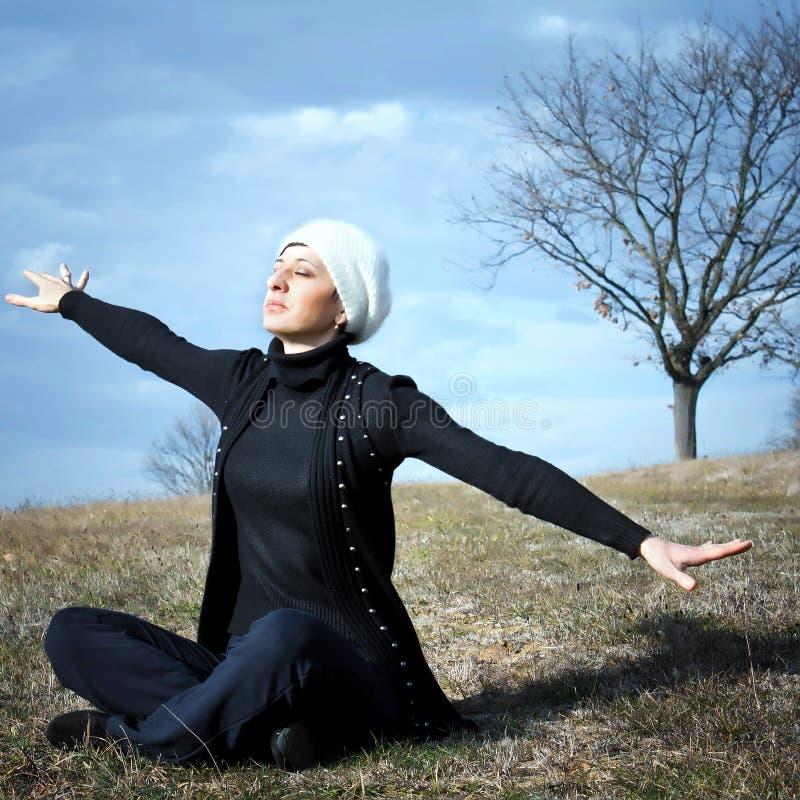 Beautiful woman enjoying the warm autumn sun royalty free stock photography