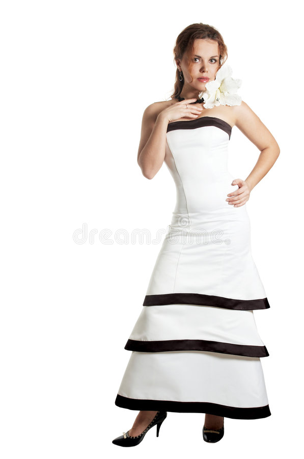 Beautiful woman in an evening dress. With white flower royalty free stock images