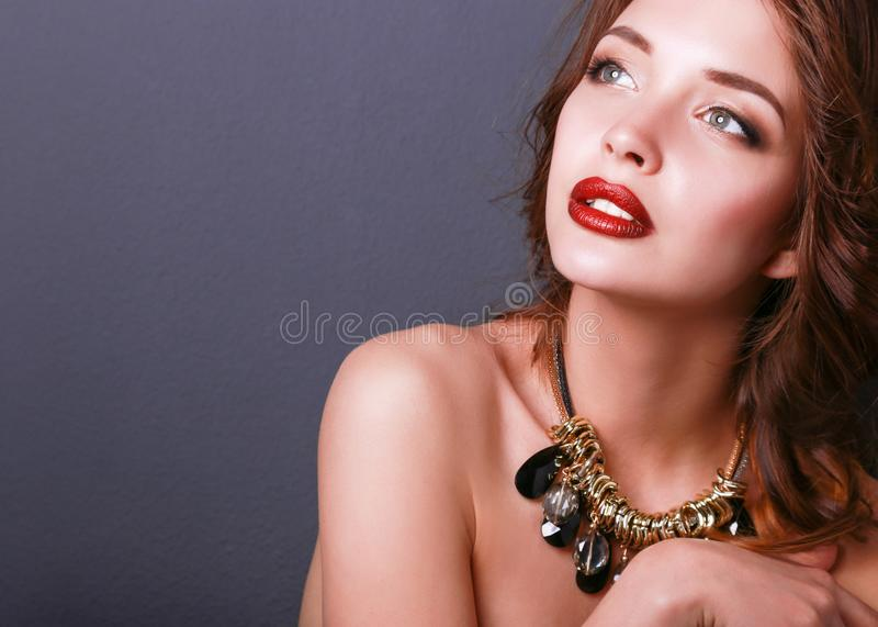 Beautiful woman with evening make-up in black dress.  stock photography