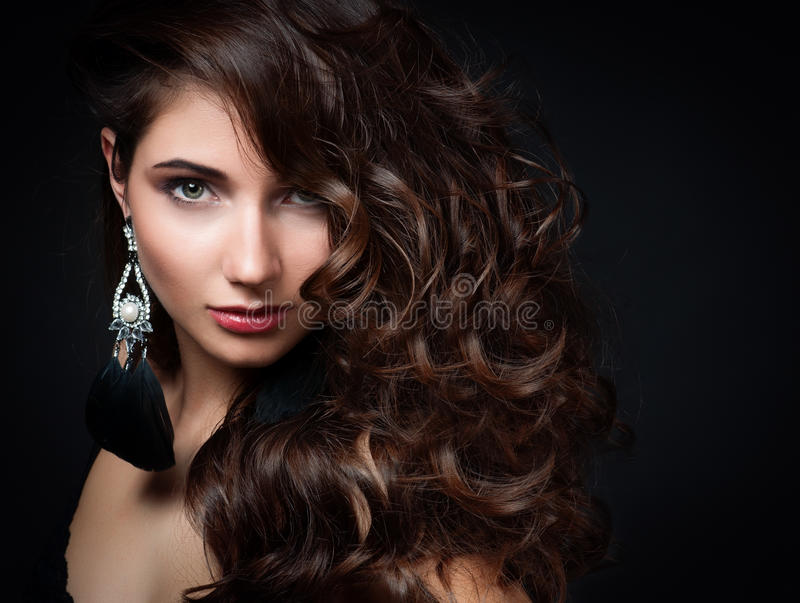 Beautiful woman with evening make-up. Jewelry and Beauty. royalty free stock images