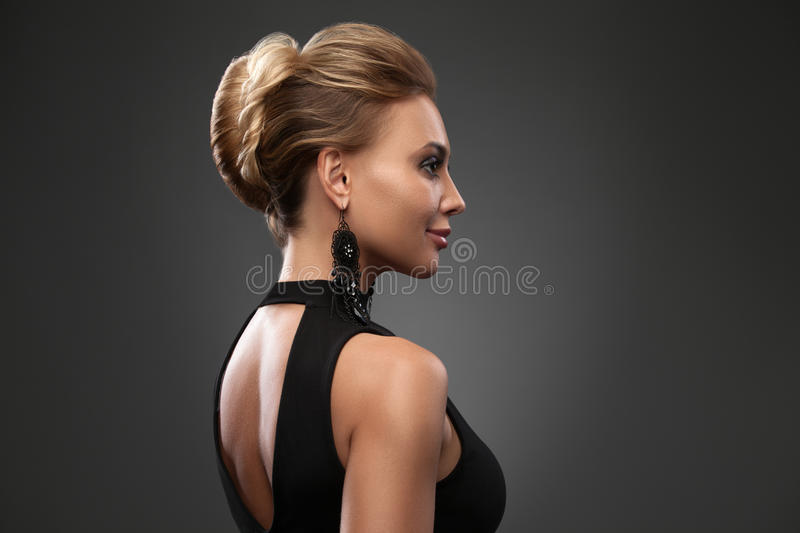 Beautiful woman with evening make-up. Jewelry and Beauty. Fashion photo. Profile lady portrait, hairdo, hairstyle royalty free stock image