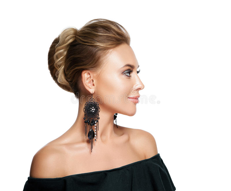 Beautiful woman with evening make-up. Jewelry and Beauty. Fashion photo. Profile lady portrait, hairdo, hairstyle. On white background royalty free stock photos