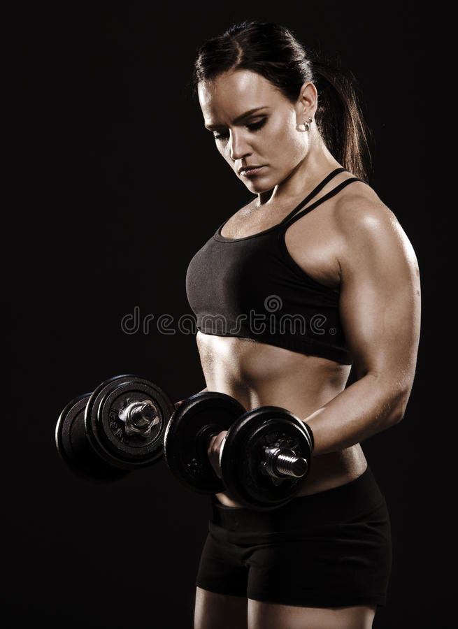 Beautiful woman exercising. stock photography