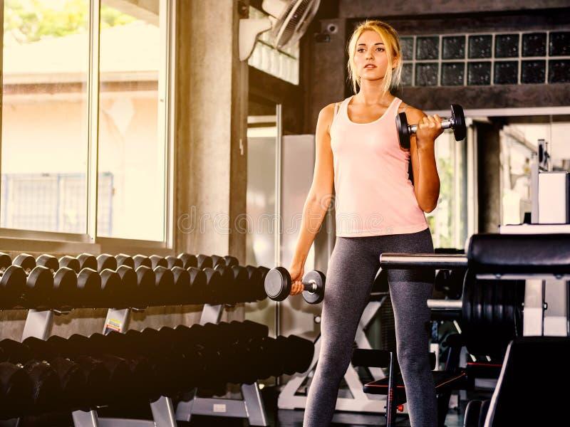Beautiful woman exercising at gym royalty free stock image