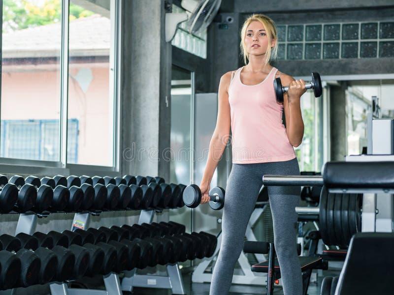 Beautiful woman exercising at gym stock photography