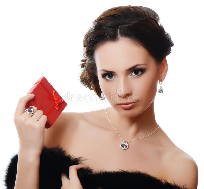 Beautiful woman with expensive jewelry royalty free stock photography