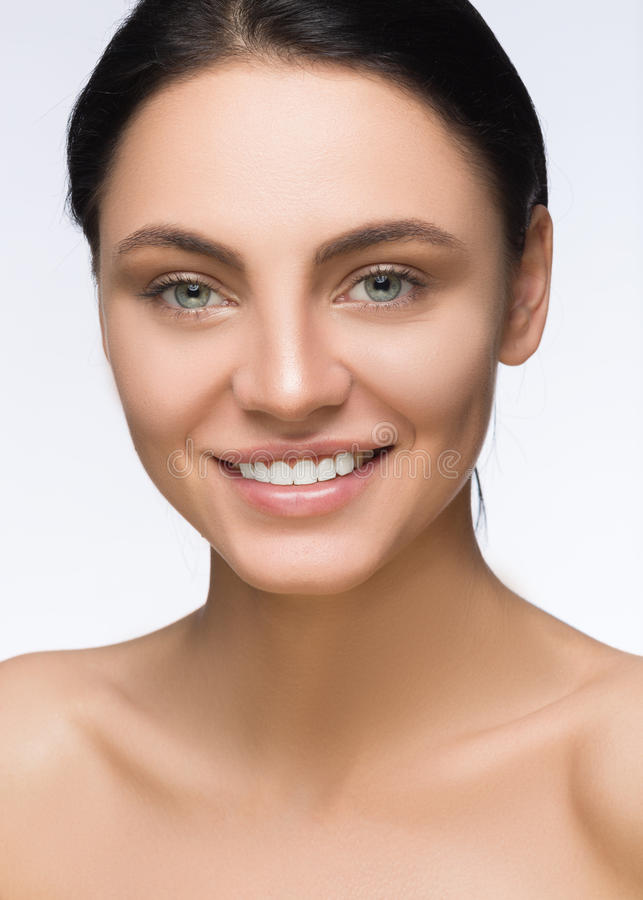 Beautiful Woman Face. Beauty Portrait. Spa smiling. Perfect Fresh Skin. Pure Model Girl. Youth and Care Concept. Brunette with. Beautiful Woman Face. Beauty royalty free stock image