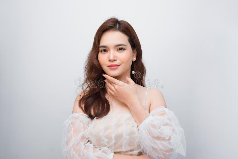 Beautiful woman face close up portrait studio on white background stock photos