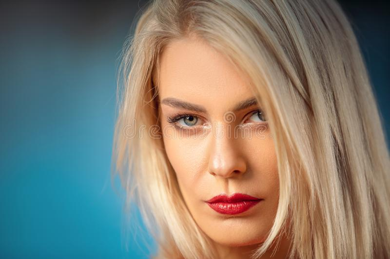 Beautiful woman face close up portrait young studio with curly long blonde amazing hair royalty free stock images