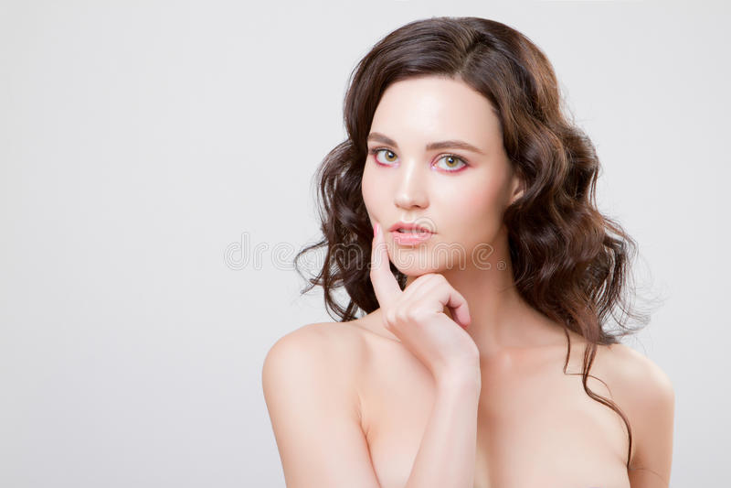 Beautiful woman face close up studio on grey stock photo