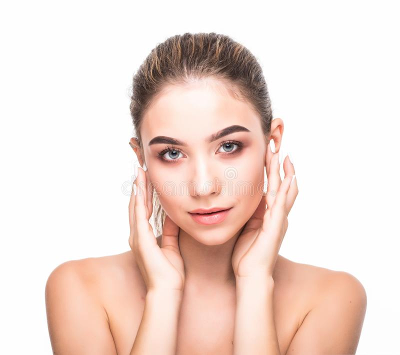 Beautiful woman face close up studio on white. Beauty spa model female, clean fresh perfect skin closeup. Youth care concept. Cosm stock photo