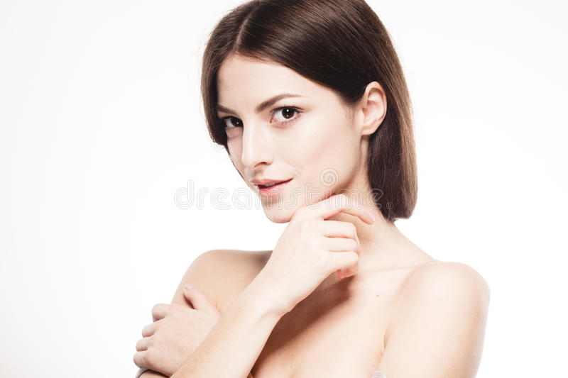 Beautiful woman face close up touching her chin by fingers studio isolated on white. Beautiful woman face studio close up touching her chin by fingers isolated royalty free stock images