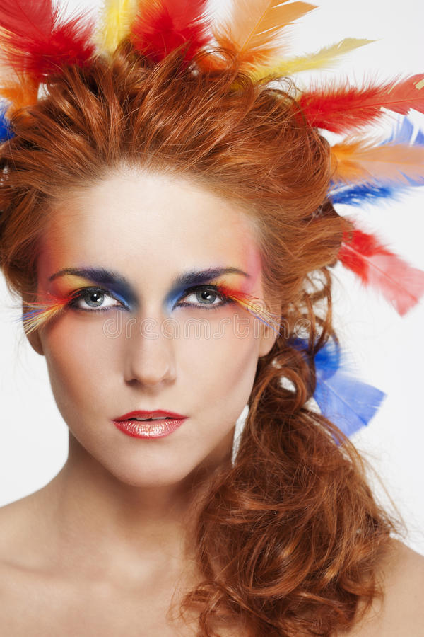 Beautiful woman with face framed in feathers stock photos