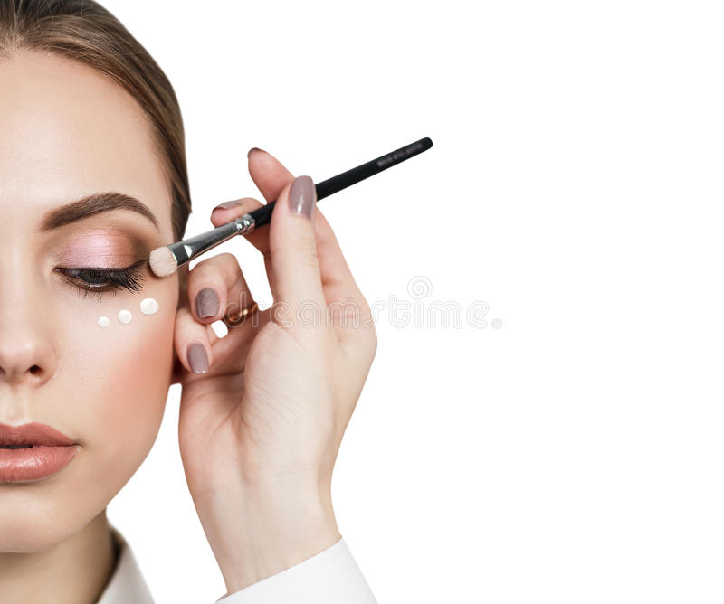 Beautiful woman face with make-up and cream royalty free stock photo