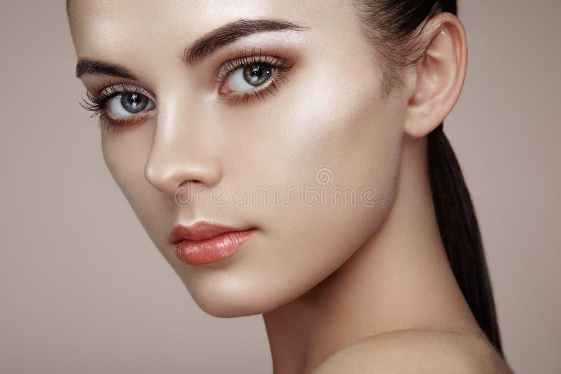 Beautiful woman face. Perfect makeup. Beauty fashion. Eyelashes. Cosmetic Eyeshadow. Highlighting stock photography