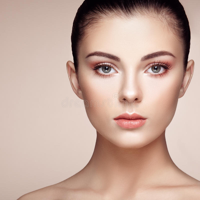 Beautiful woman face. Perfect makeup. Beauty fashion. Eyelashes. Cosmetic Eyeshadow. Highlighting royalty free stock image