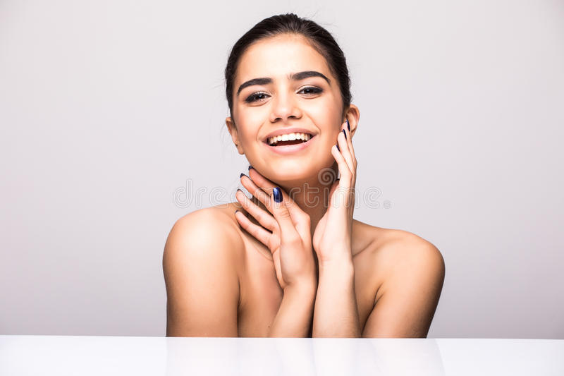 Beautiful woman face portrait beauty skin care concept. Fashion Beauty Model isolated on grey. Beautiful Woman Face Portrait Beauty Skin Care Concept royalty free stock photo