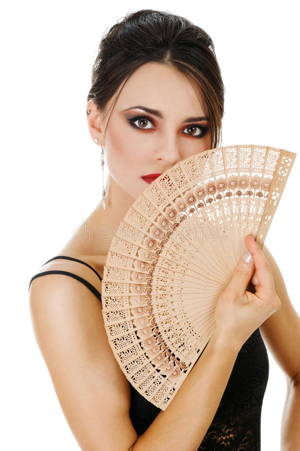 Beautiful woman with fan. Beautiful young woman with fan isolated over white background stock photography
